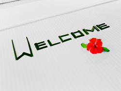 "The word ""Welcome"" with a red flower"